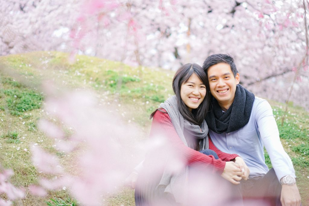 Engagement photoshoot with cherry blossoms by freelance wedding photographer in Kyoto